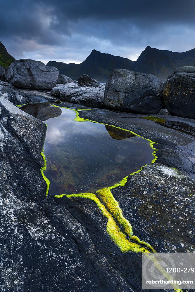 Rock formations and reflection, Tungeneset, Senja, Norway, Scandinavia, Europe
