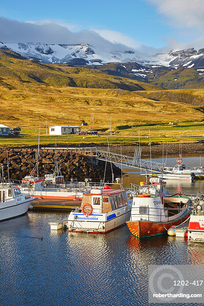 Fishing boats in the harbour at Grundarfjordur, with a mountainous backdrop, on the Snaefellsnes peninsula, west Iceland, Polar Regions