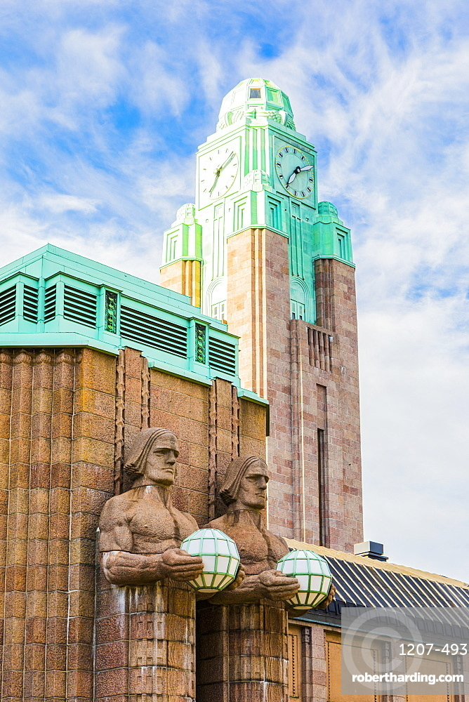 Emil Wikstrom's statues on Helsinki Central Station in Helsinki, Finland, Europe