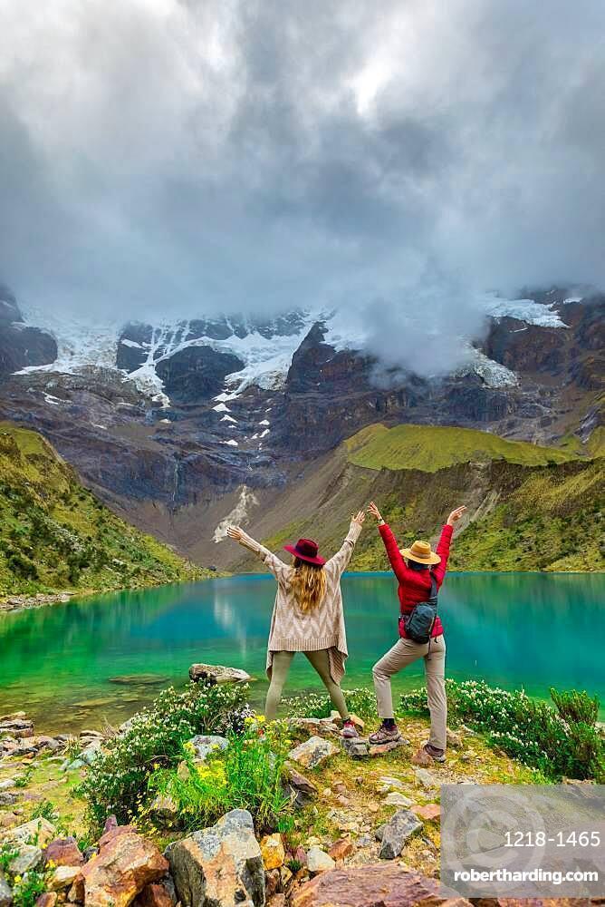 Two woman trekking Humantay Lake, Cusco, Peru, South America