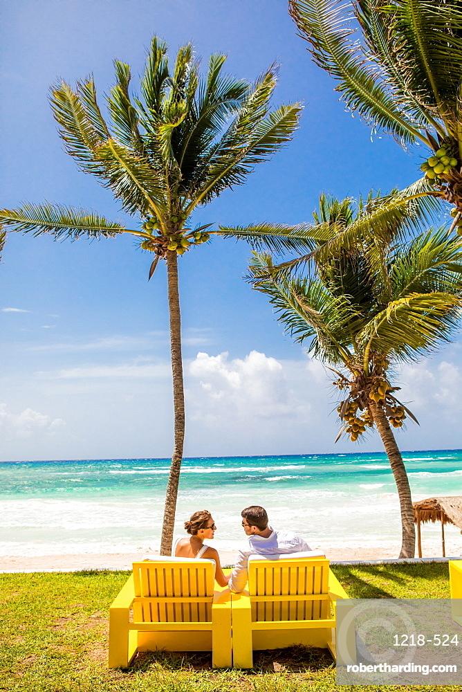 Couple beachside in Tulum, Yucatan, Quintana Roo, Mexico, North America