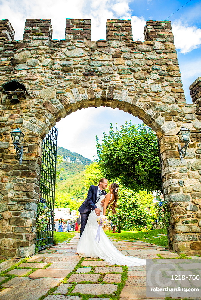 Couple, bride and groom, posing at the Castello di Rossino, Lake Como, Lombardy, Italy, Europe