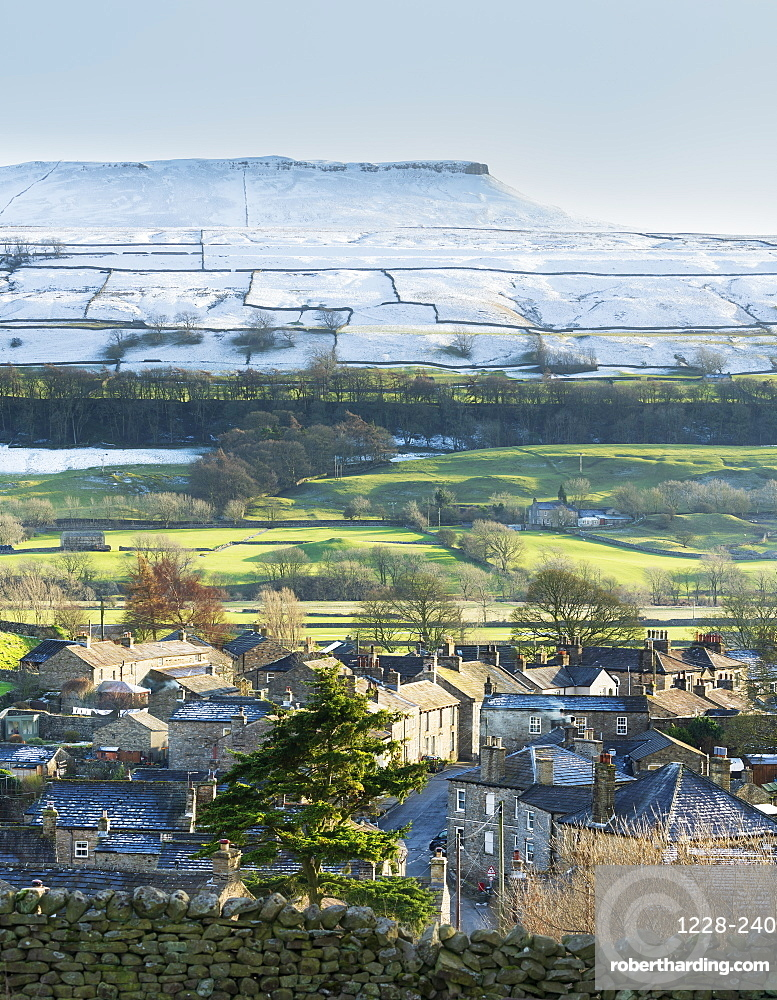 Askrigg village and snow capped Addlebrough in upper Wensleydale, The Yorkshire Dales, Yorkshire, England, United Kingdom, Europe