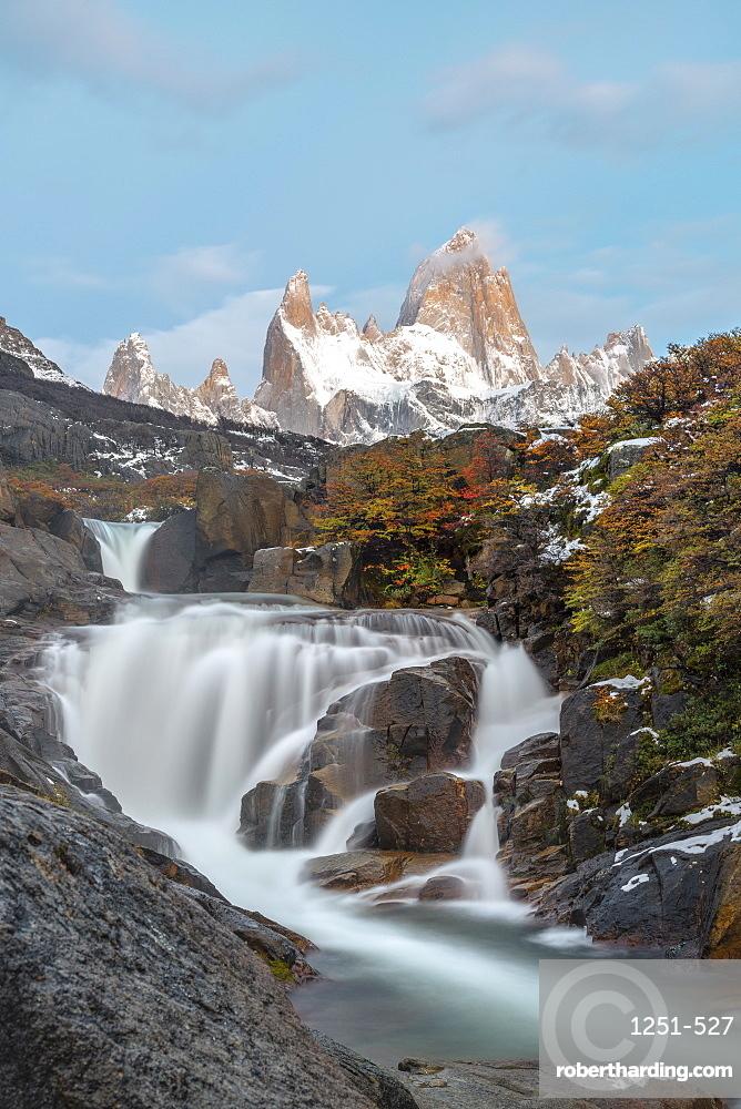 Secret waterfall and Fitz Roy at sunrise, El Chalten, Los Glaciares National Park, UNESCO World Heritage Site, Santa Cruz province, Argentina, South America