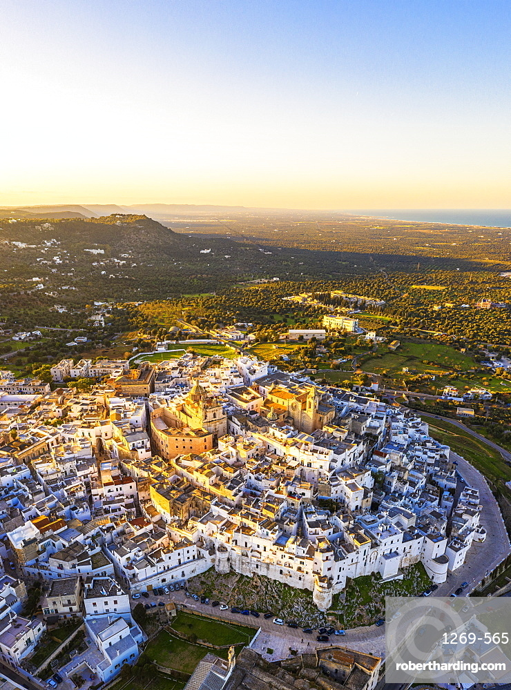 Aerial view of the old town of Ostuni at sunset, Apulia, Italy, Europe