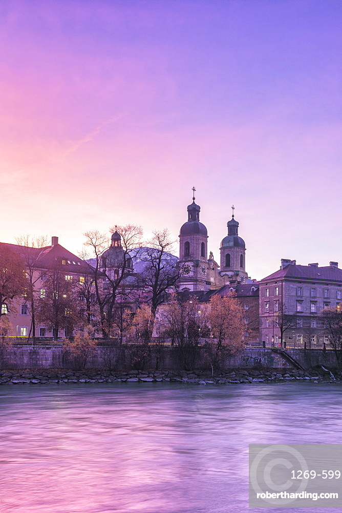 Cathedral of St. James is reflected in Inn River at sunrise, Innsbruck, Tyrol, Austria, Europe