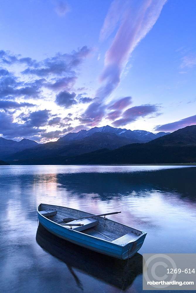 Single moored boat in the Lake of Sils at sunrise, Maloja pass, Engadine valley, Graubunden, Switzerland, Europe