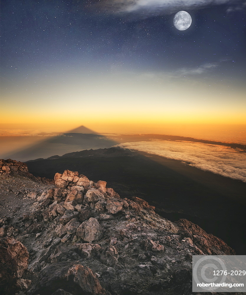 View of El Teide volcano shadow and full moon from the summit right before the sunrise, El Teide National Park, UNESCO World Heritage Site, Tenerife, Canary Islands, Spain, Atlantic, Europe