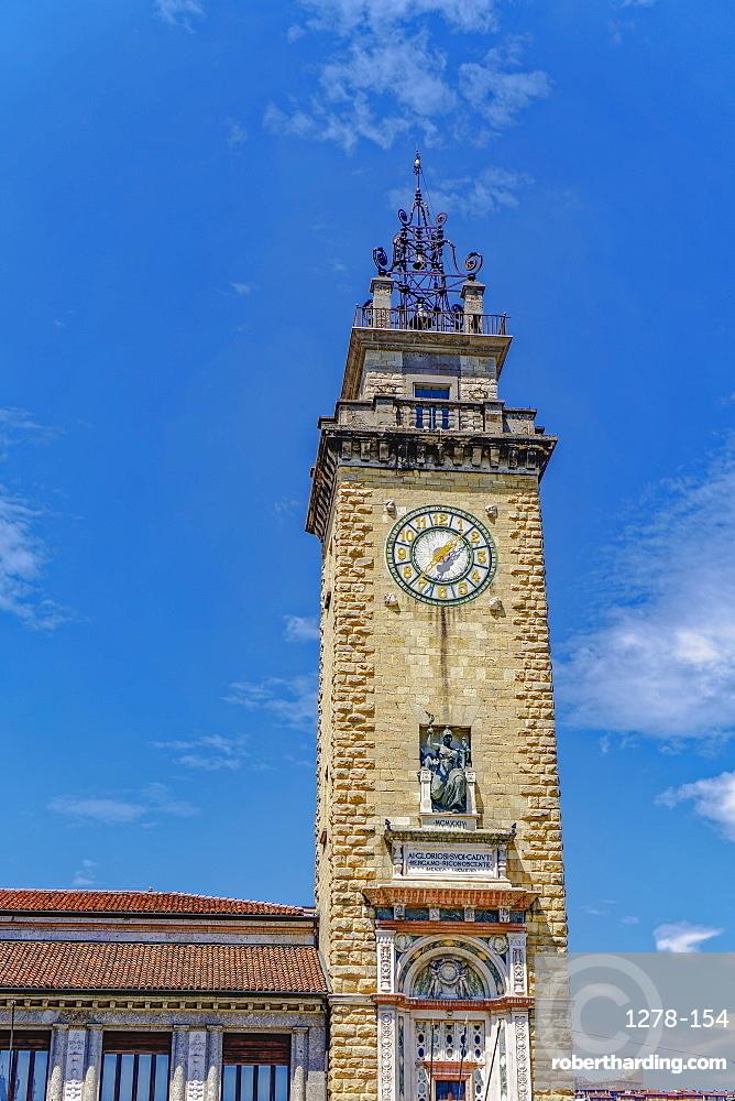 Day view of Torre dei Caduti with clock, 1924 historic stone Tower of The Fallen, at Piazza Vittorio Veneto, Bergamo, Lombardy, Italy, Europe