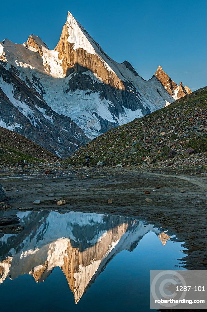 Laila Peak in the Hushe Valley, Karakoram range in Gilgit-Baltistan, Pakistan, reflecting in small pond in the valley at sunrise