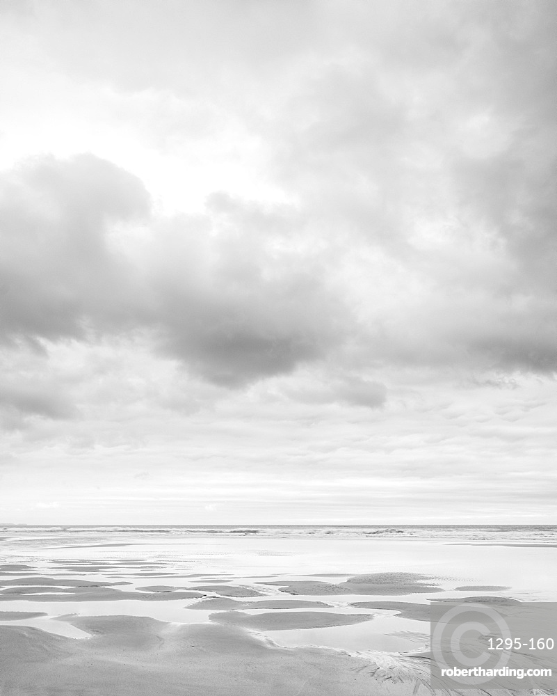 Cloud formations and wet sand on the vast expanse of beach at Sandymouth, Bude, Cornwall, England, United Kingdom, Europe