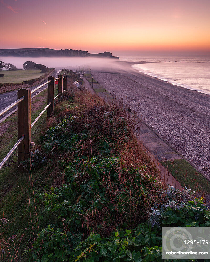 Winter twilight and heavy band of mist from River Otter at Budliegh Salterton, Devon, UK