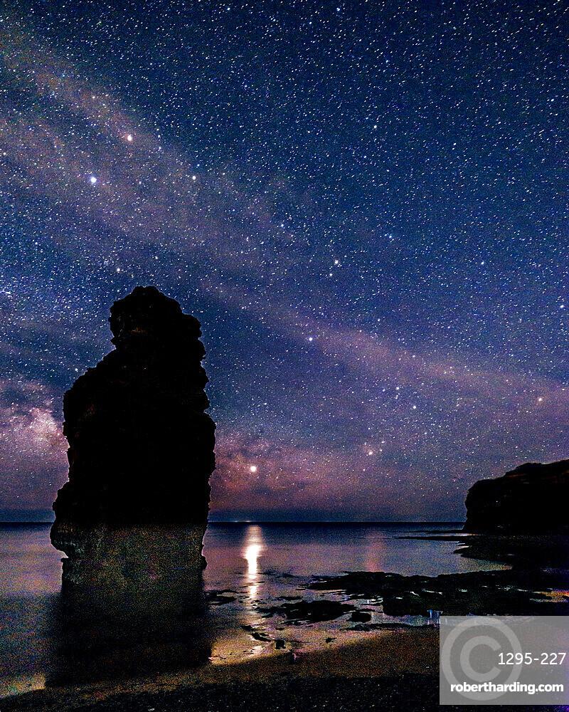 Milky Way and Jupiter beyond a majestic sea stack at Ladram Bay, Sidmouth, Devon, UK