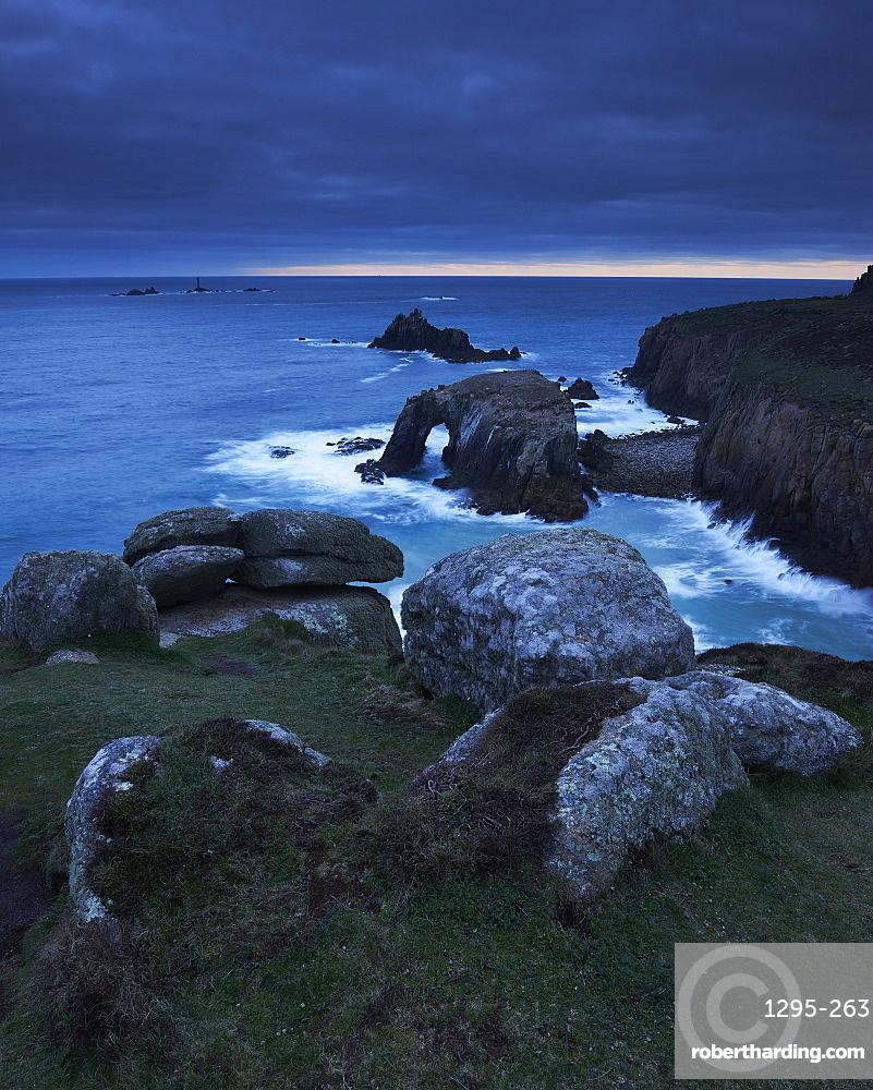 Sunset at Land's End over Enys Dodman rock arch, Longships Lighthouse, Cornwall, England, United Kingdom, Europe