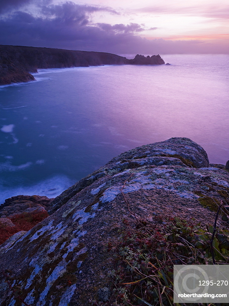 Sunrise from the Minack Theatre looking out towards Logan Rock at Porthcurno, Cornwall, England, United Kingdom, Europe