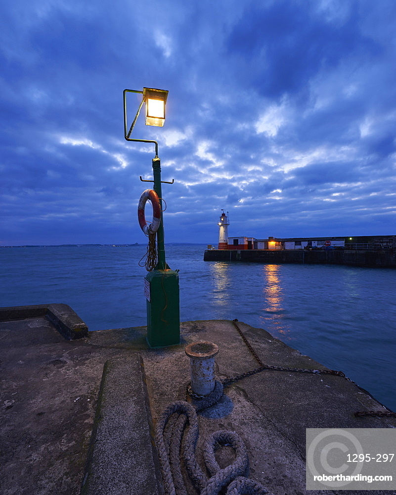 Lights at end of harbour walls in twilight, Newlyn, Cornwall, England, United Kingdom, Europe