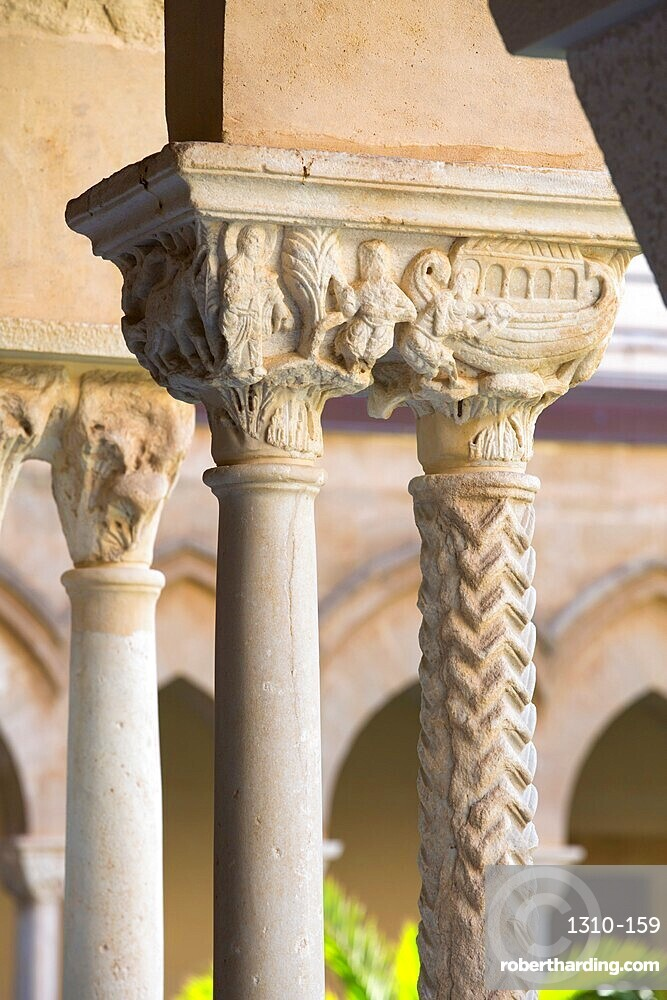 Columns with finely carved capital in cloister of the UNESCO listed Arab-Norman cathedral, Cefalu, Palermo, Sicily, Italy