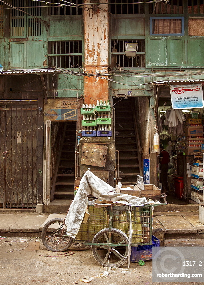 An old drinks cart outside an old building in Chinatown, Yangon (Rangoon), Myanmar (Burma), Asia