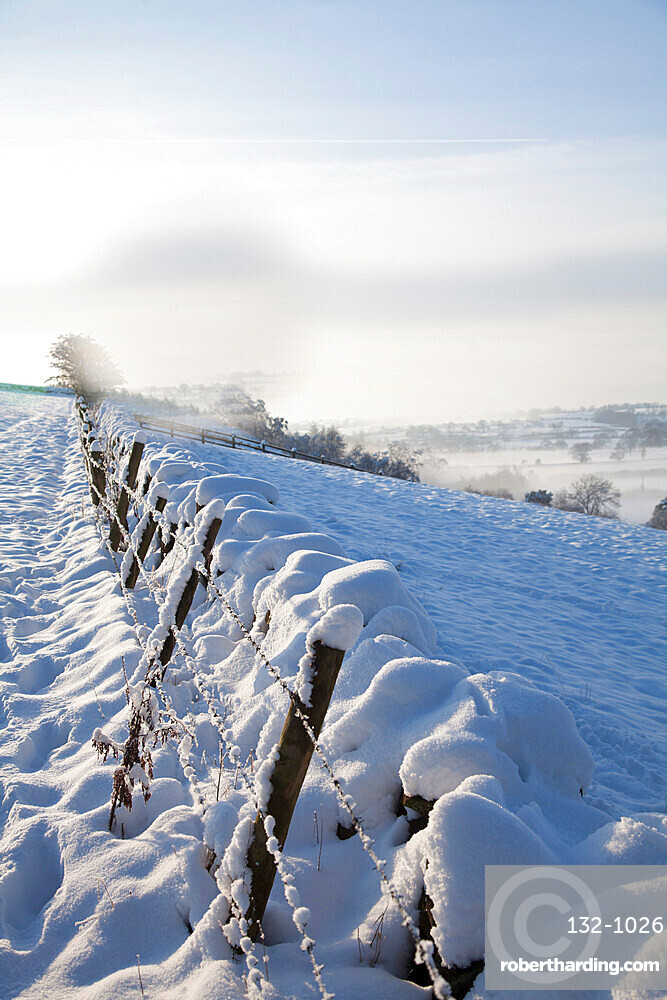 Snow covered dry stone wall, near Almscliff Crag, Wharfe Valley, North Yorkshire, England, United Kingdom, Europe
