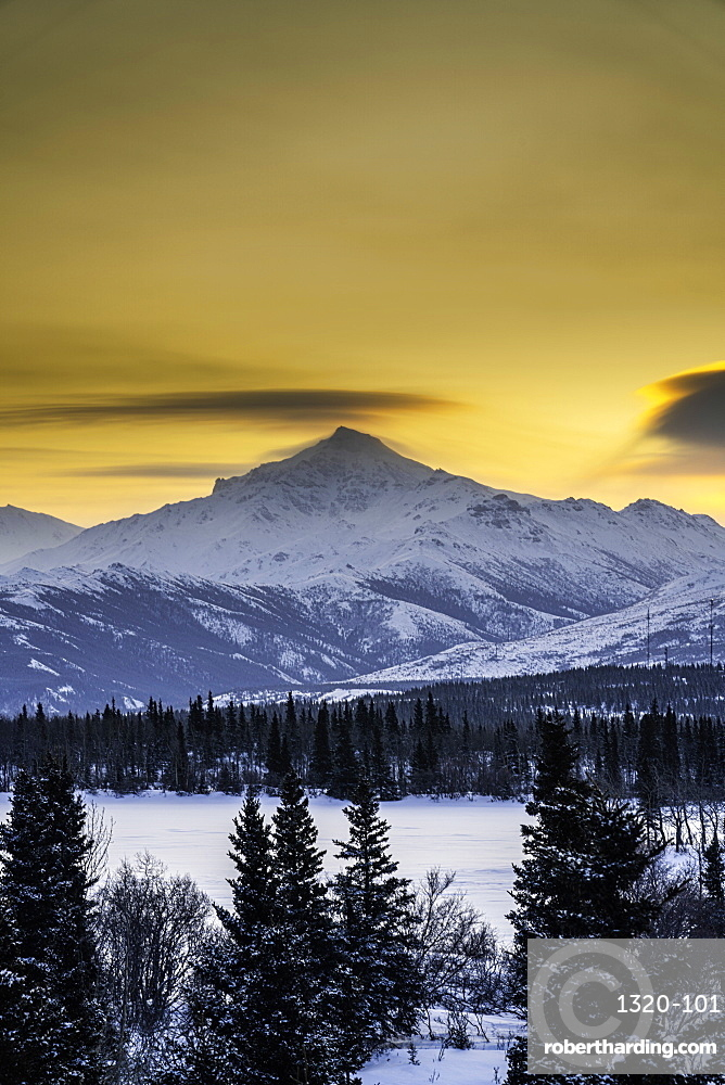 Sunrise over the frozen Otto Lake and snowy mountains of Denali National Park in the background, Alaska, United States of America, North America
