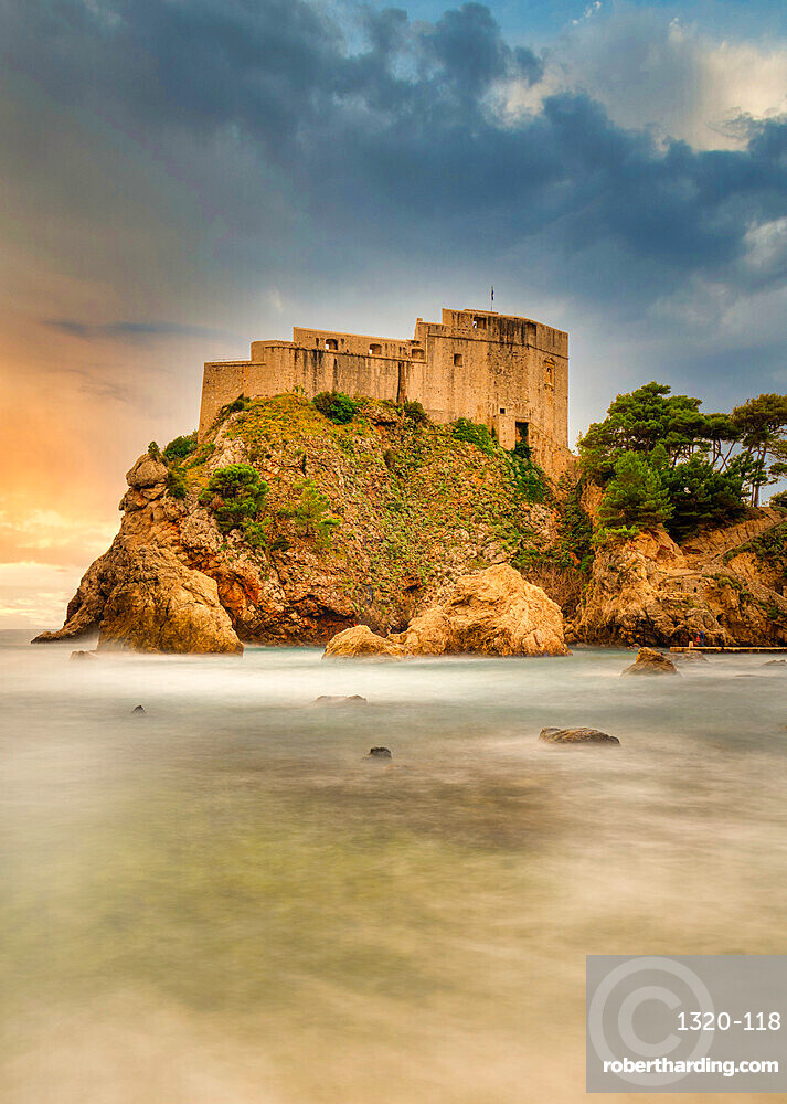 The 16th Century Lovrjenac Fortress at sunset with a long exposure ocean foreground. Dubrovnik, Croatia.