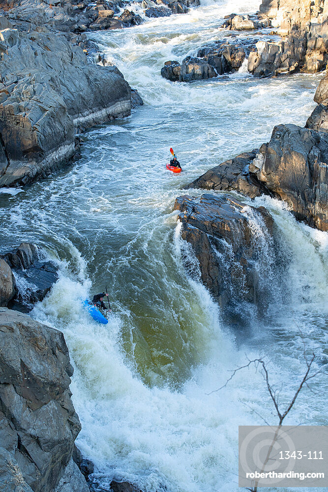 Kayaker Ian Brown heads off the Spout, the last drop of Great Falls of the Potomac River, Virginia, United States of America, North America