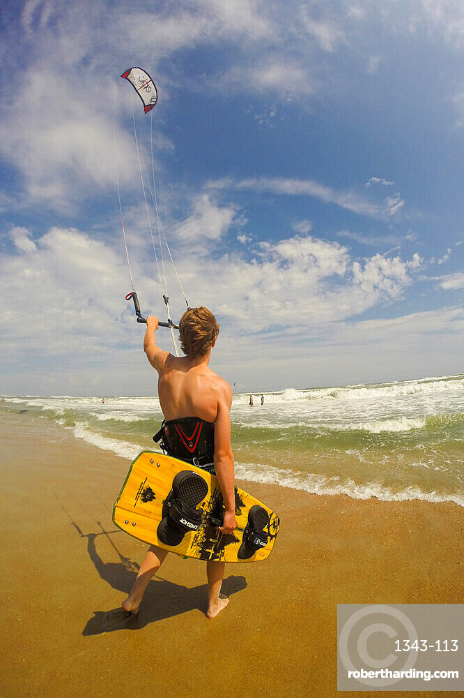 A kiteboarder heads out into the Atlantic Ocean off Cape Hatteras, North Carolina, United States of America, North America