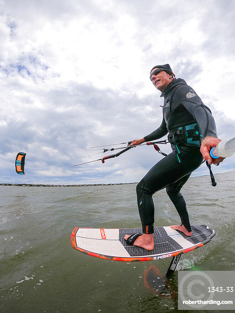 Photographer Skip Brown on his foiling kiteboard on the Pamlico Sound, Nags Head, North Carolina, United States of America, North America