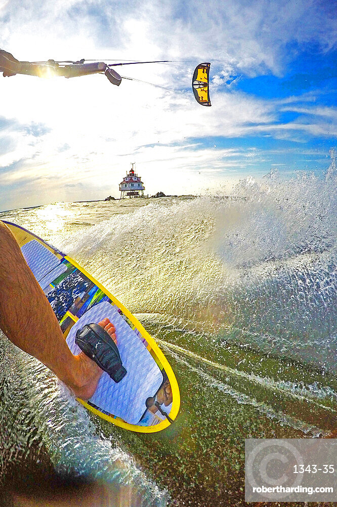 Photographer Skip Brown kiteboards next to Thomas Point Lighthouse on Chesapeake Bay near Annapolis, Maryland, United States of America, North America