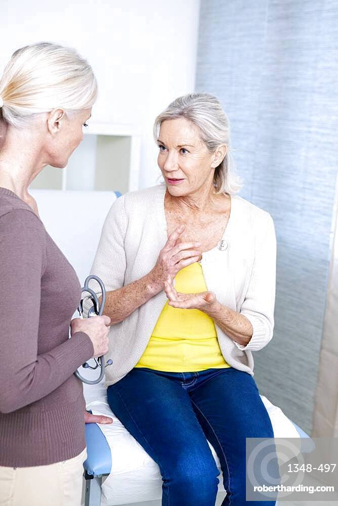 Female patient and doctor talking.