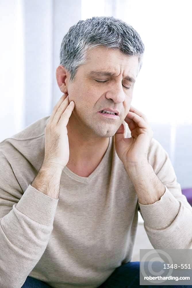 Man with earache.