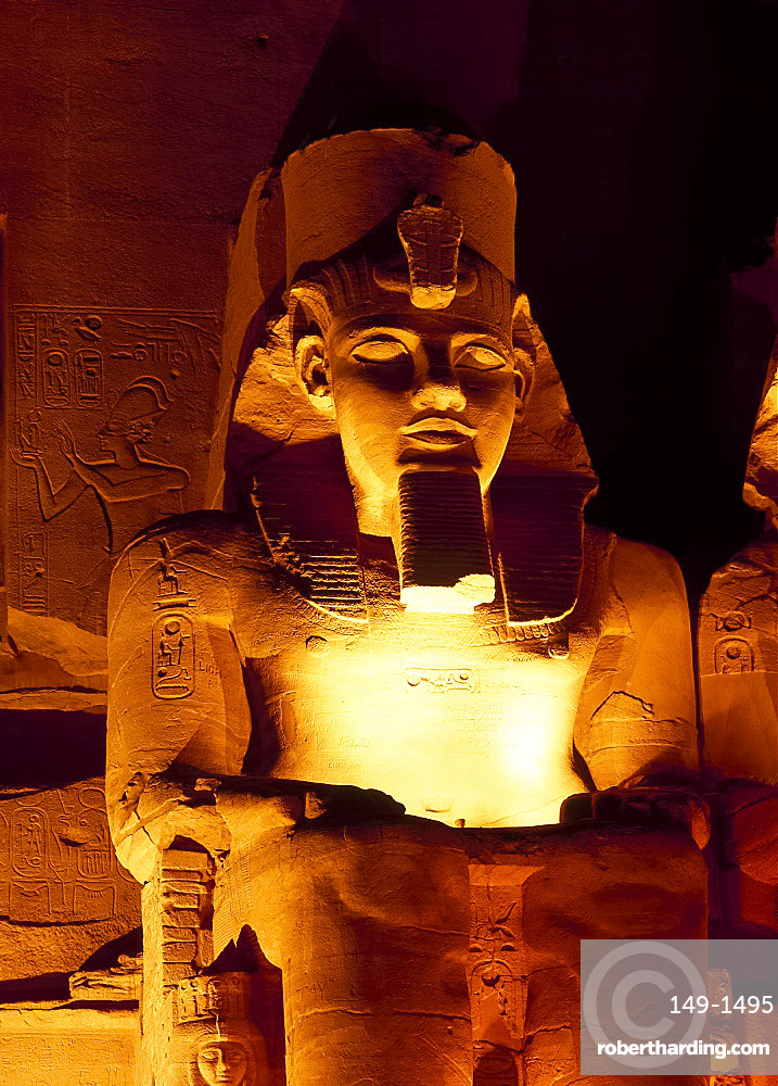 """The colossi of Ramses II, outside the Temple of Re-Herakhte, Abu Simbel, Nubia, Egypt, Africa *** Local Caption *** """"Built for Ramses II it is  also known as the Sun or Great Temple of Ramses II, moved to current site when the Aswan High Dam was built"""""""