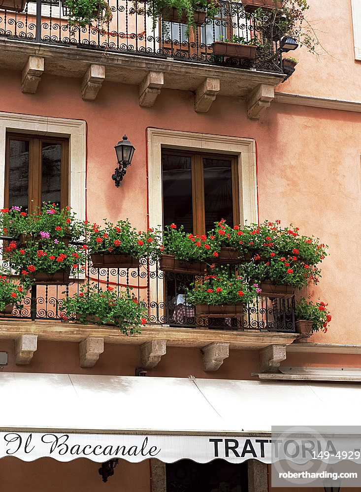 Flowers in window boxes on balconies, Taormina, Sicily, Italy, Europe
