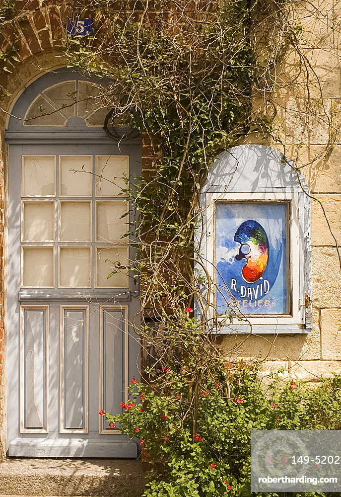 An artist's sign and old blue door in Beaumont en Auge, Pays d'Auge, Normandy, France, Europe