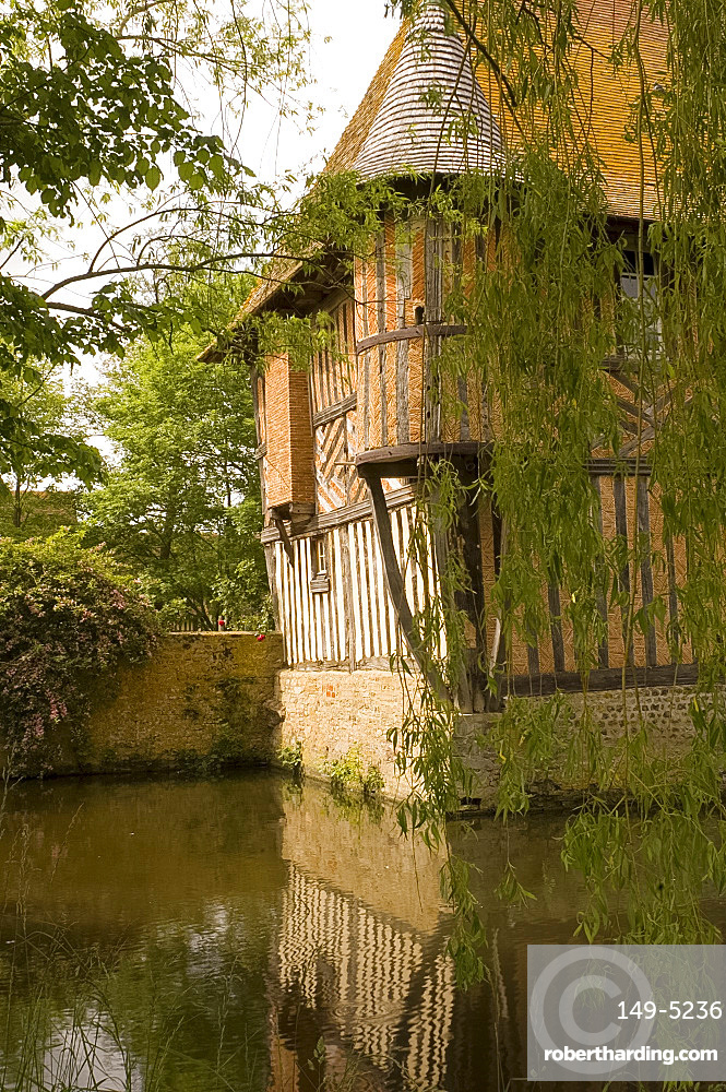 The half timbered manoire (manor house) and surrounding moat in Coupesarte, Basse Normandie (Normandy), France, Europe