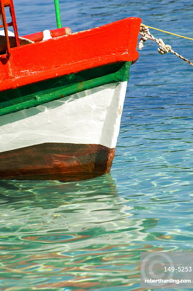 A colourful fishing boat in the harbour in Loggos, Paxos, Ionian Islands, Greek Islands, Greece, Europe