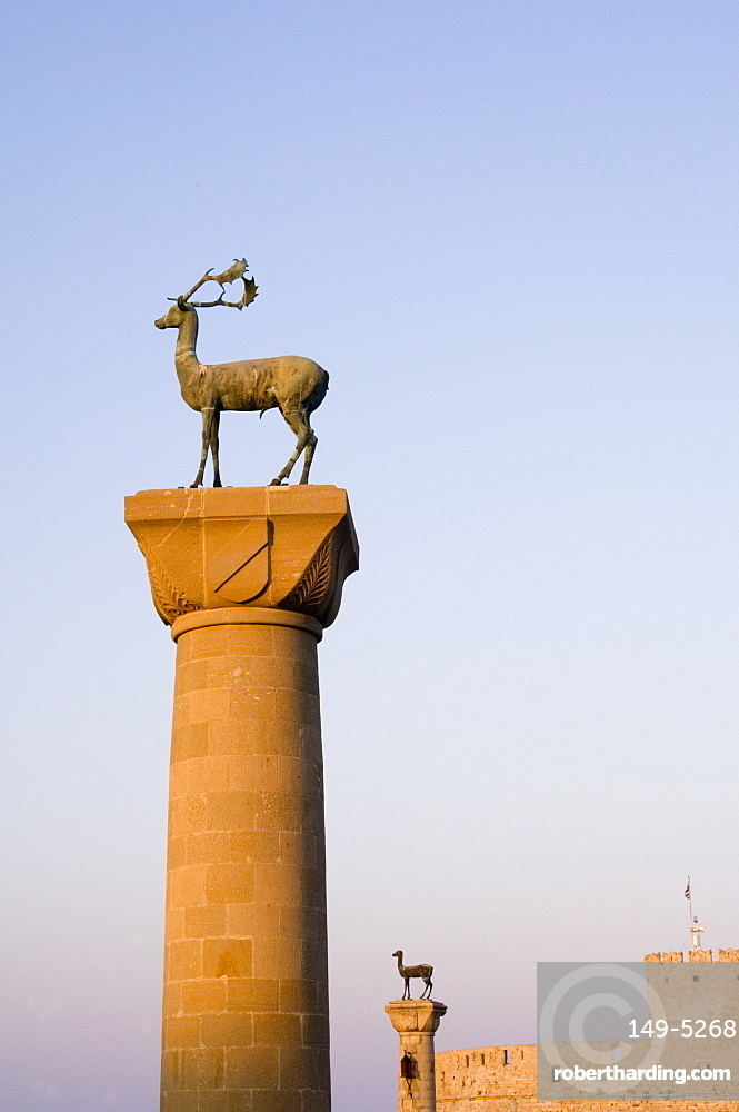 Stag and doe statues atop pillars at the entrance to Mandraki Harbour, Rhodes, Dodecanese Islands, Greek Islands, Greece, Europe