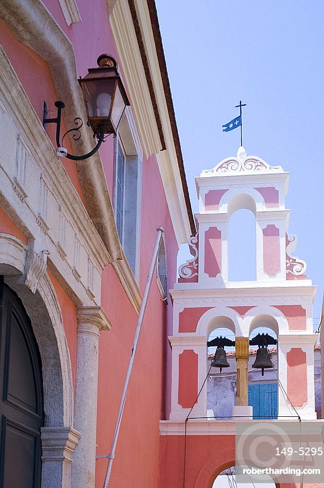 The pink and white belltower of Agios Triada in Gaios, Paxos, Ionian Islands, Greek Islands, Greece, Europe