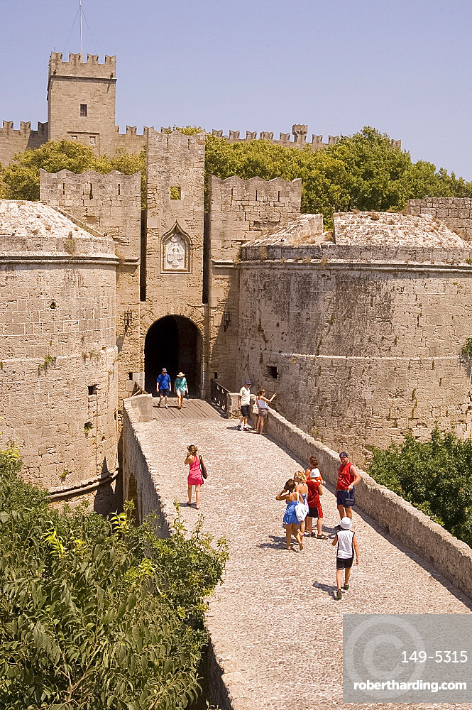 Tourists at the D'Amboise Gate and city walls around Rhodes Town, Rhodes, Dodecanese, Greek Islands, Greece, Europe