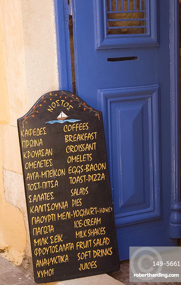 A chalkboard menu outside a taverna on a small back street in Hania, Crete, Greek Islands, Greece, Europe