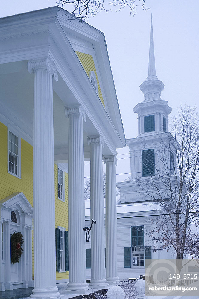 A traditional style white church with steeple during a snow storm, Rensselaerville, New York State, United States of America, North America