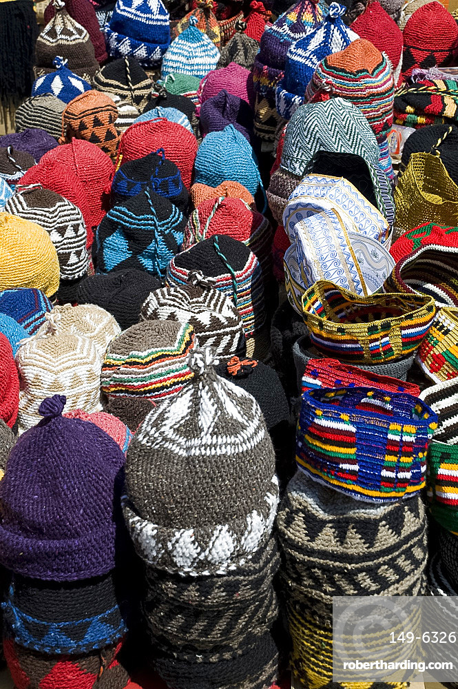 Brightly coloured knitted wool hats for sale in the souk in Marrakech, Morocco, North Africa, Africa