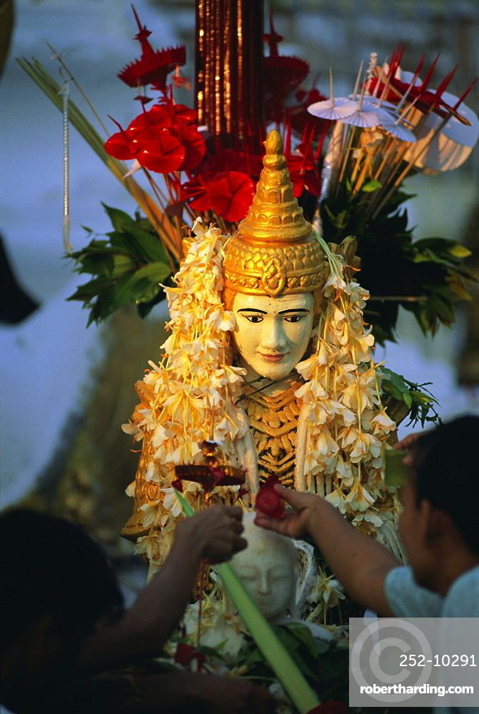 Religious offerings at the Shwedagon Paya (Shwe Dagon Pagoda), Yangon (Rangoon), Myanmar (Burma), Asia