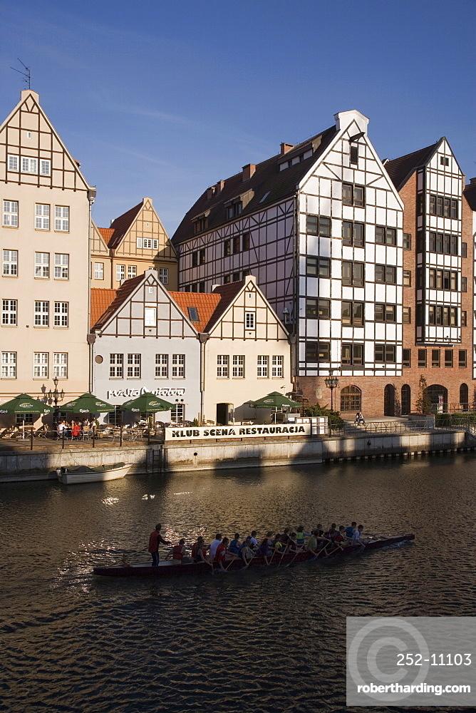 Restored warehouses along the Stara Motlawa River (Mottla River), Gdansk, Pomerania, Poland, Europe