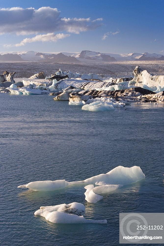 Icebergs floating in the Lagoon beneath Breidamerkurjokull Glacier, Jokulsarlon (Glacial River Lagoon), southern Vatnajokull, southern area, Iceland, Polar Regions