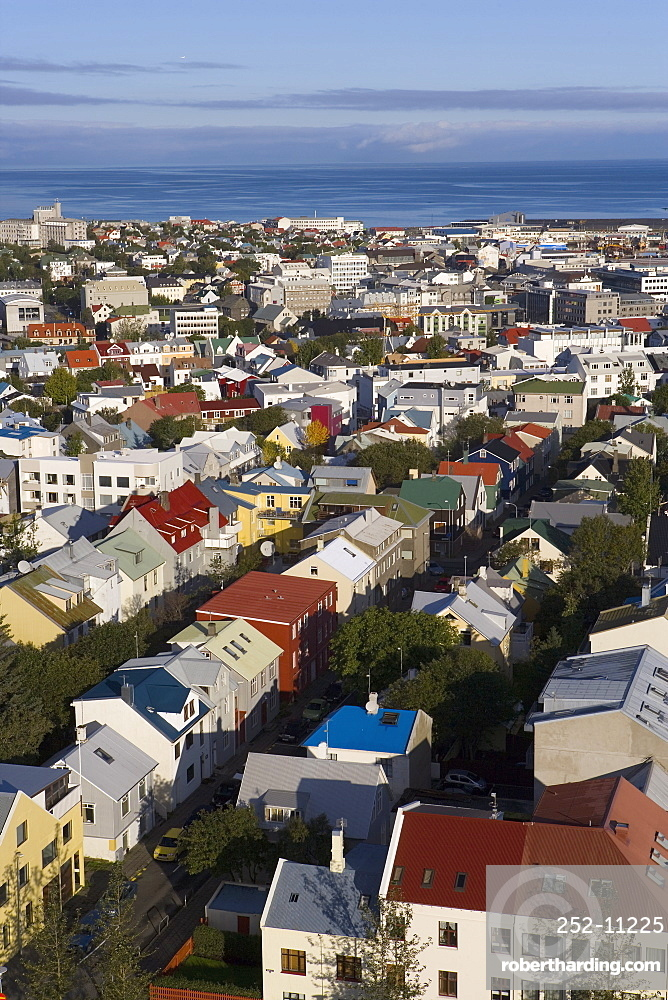 Low aerial view from Hallgrimskirkja of colourful houses, commercial buildings and harbour of the capital city, Reykjavik, Iceland, Polar Regions