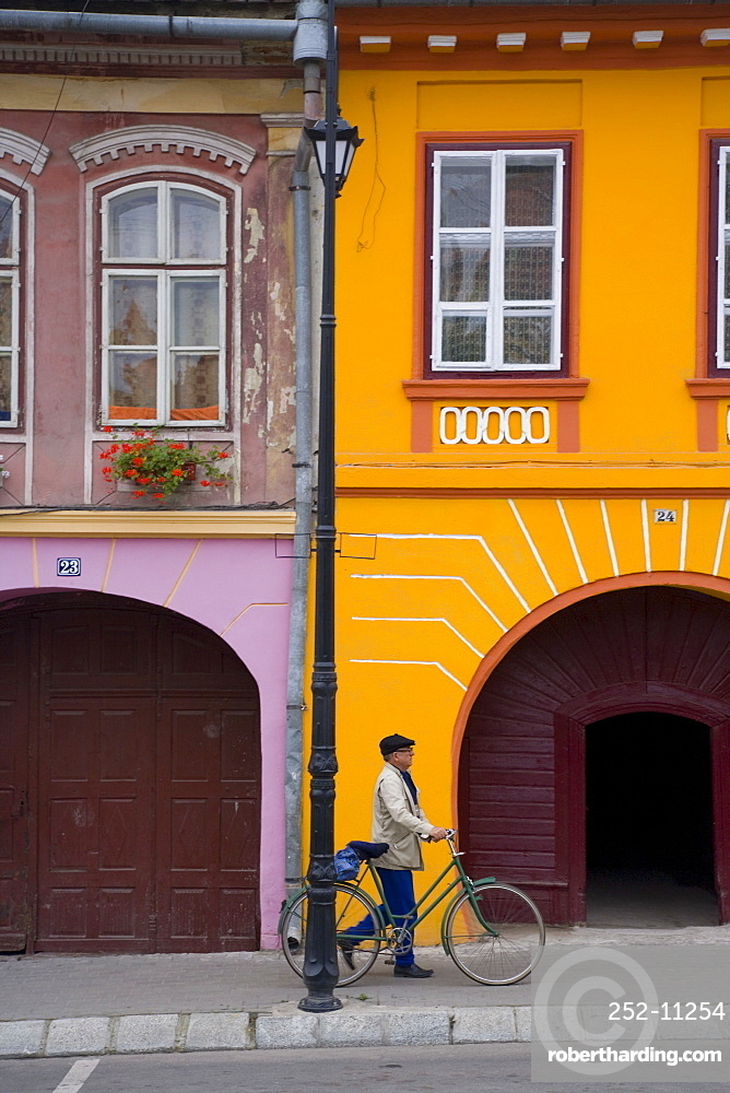 Detail of colourfully painted houses in medieval citadel town, Sighisoara, UNESCO World Heritage Site, Transylvania, Romania, Europe