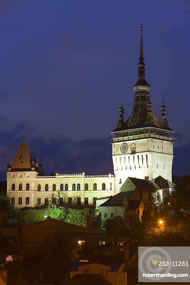 Clock tower (Turnul cu Ceas), illuminated at dusk, formerly the main entrance to the fortified city, in the medieval old town or citadel, Sighisoara, UNESCO World Heritage Site, Transylvania, Romania, Europe