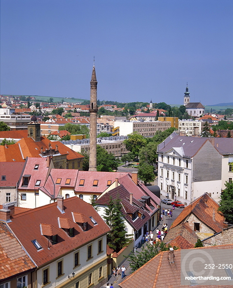 Houses, the Turkish minaret, and churches in the town of Eger, Hungary