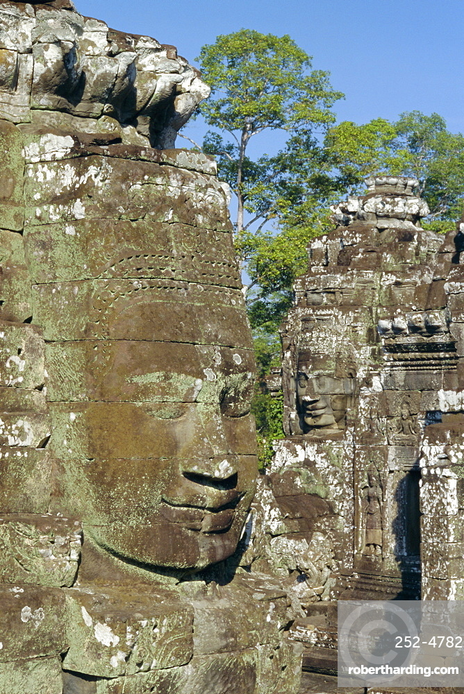 Myriad stone heads typifying Cambodia in the Bayon Temple, Angkor, Siem Reap, Cambodia